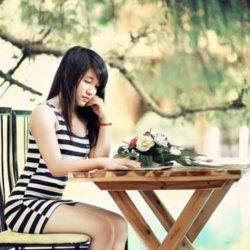 Thai-Lady-Sitting-on-Bench