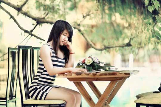 Thai Lady Sitting on Bench